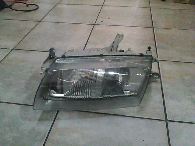 Scheinwerfer Links - Bosch Mazda 323